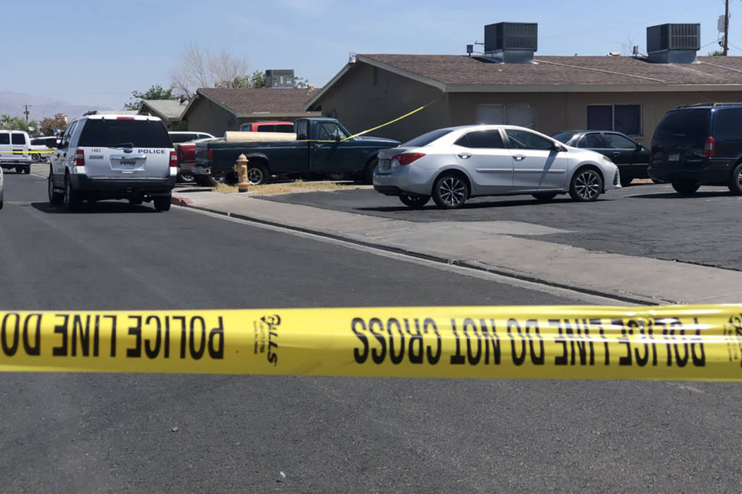 North Las Vegas police investigate a second homicide Saturday morning at the same location of Friday's triple shooting that left one man dead. (Rio Lacanlale/Las Vegas Review-Journal) @riolacanlale