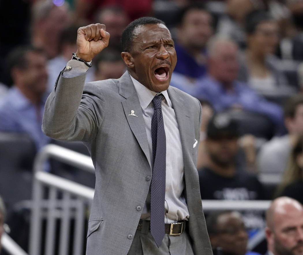 In this Feb. 28, 2018, file photo, Toronto Raptors head coach Dwane Casey directs his players during the second half of an NBA basketball game against the Orlando Magic, in Orlando, Fla. (AP Photo ...