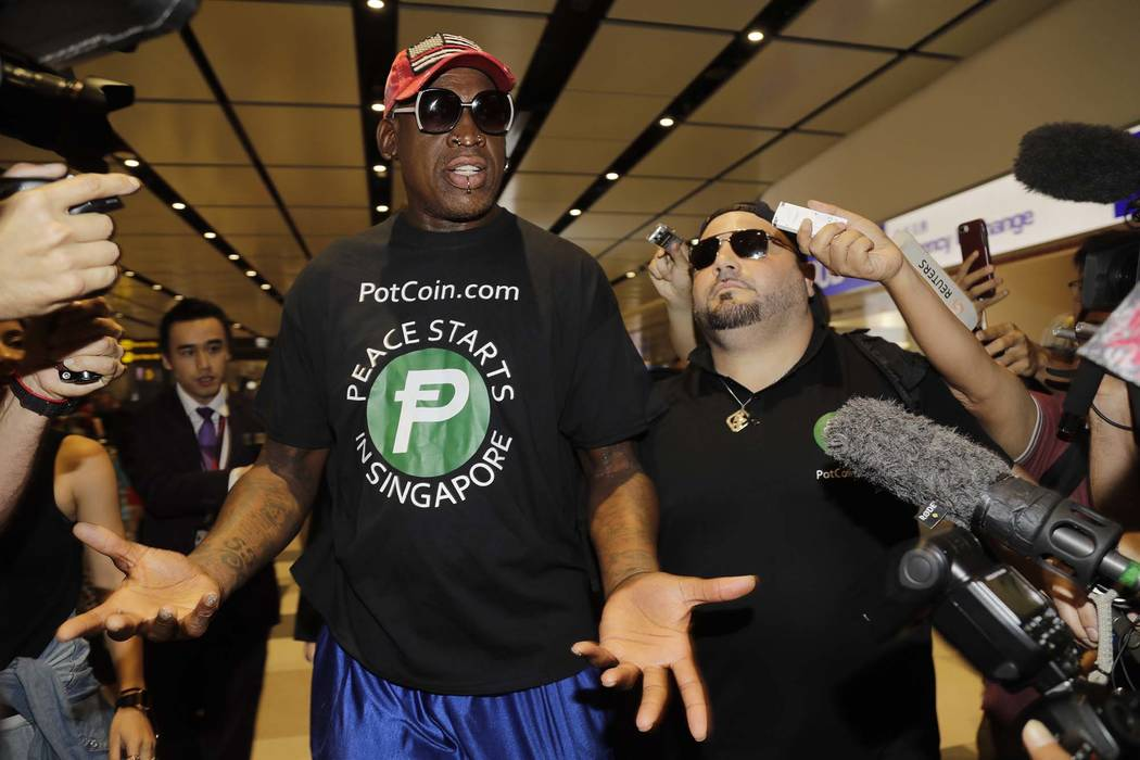 Former NBA basketball player Dennis Rodman, and Chris Volo, right, arrive at Singapore's Changi Airport on Tuesday, June 12, 2018. (Wong Maye-E/AP)