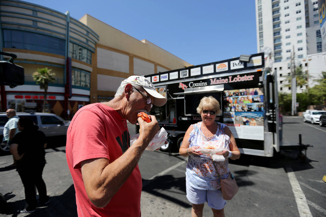 Bill and Kathy Forbes share lobster rolls from Cousins Maine Lobster food trailer on the corner of Fremont Street and Las Vegas Boulevard in downtown Las Vegas Monday, June 11, 2018. The food truc ...