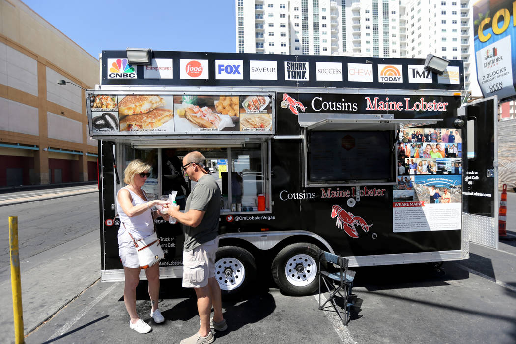 Shaun and Melissa Leary of Myrtle Beach. S.C. share lobster rolls Cousins Maine Lobster food trailer on the corner of Fremont Street and Las Vegas Boulevard in downtown Las Vegas Monday, June 11, ...