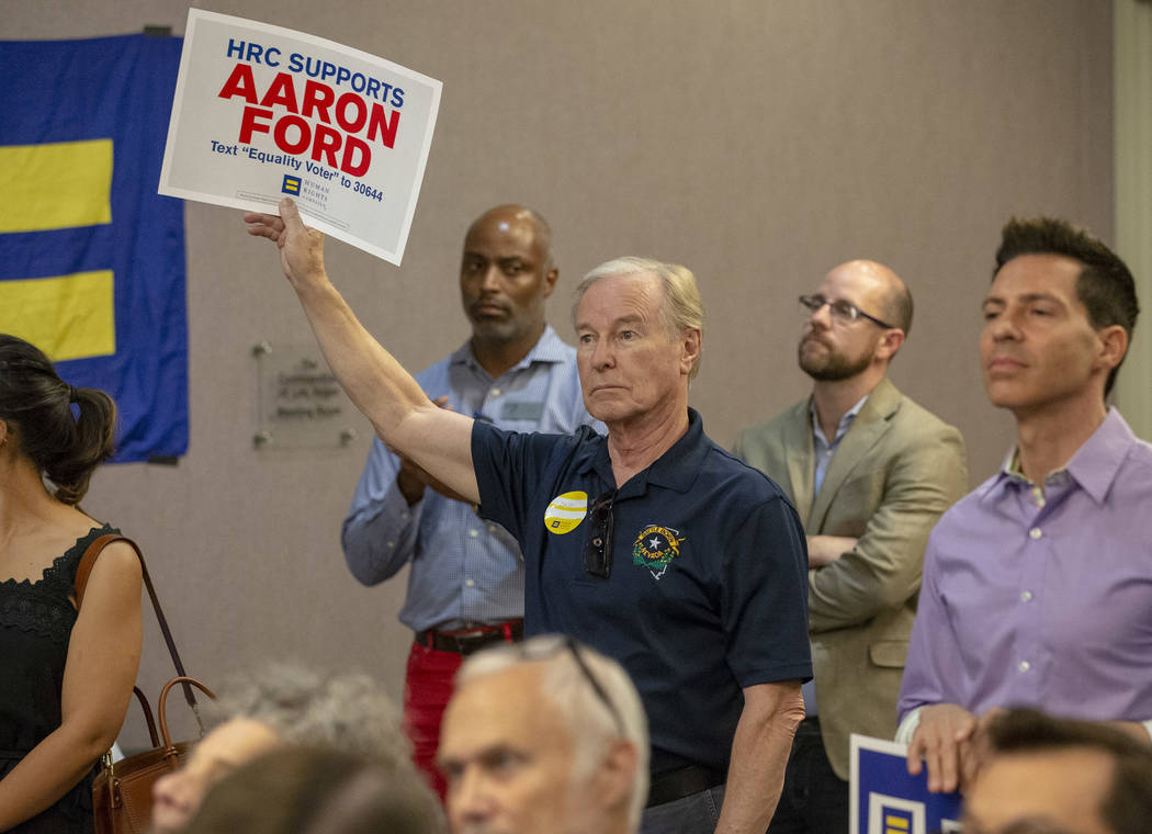 Senator David Parks, D-Las Vegas, holds a sign in support of fellow Senator and Attorney General candidate Aaron Ford during a Get Out the Vote rally hosted by the Human Rights Campaign at The Gay ...