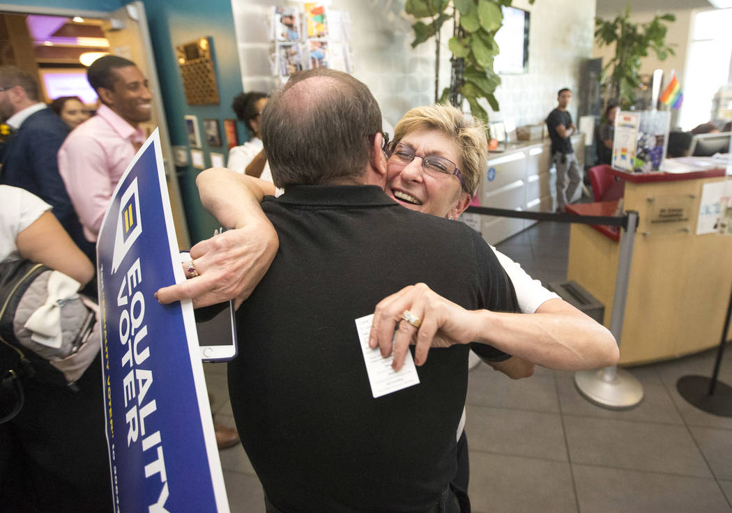 Democratic gubernatorial candidate Chris Giunchigliani, right, hugs longtime friend and supporter Ron Quinn before a Get Out the Vote rally hosted by the Human Rights Campaign at The Gay and Lesbi ...