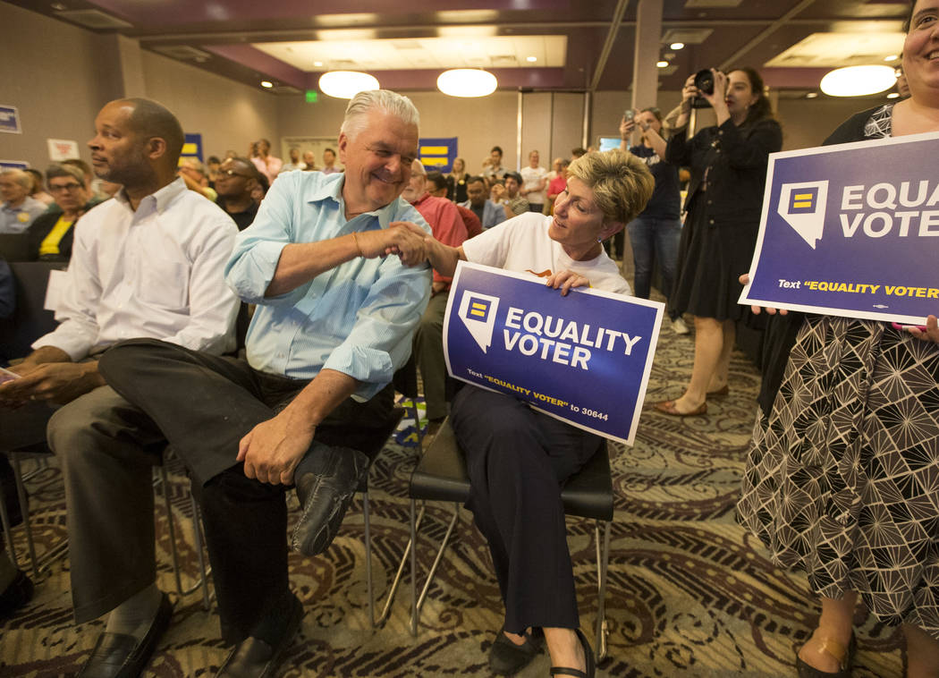 Democratic gubernatorial candidates Steve Sisolak, second left, and Chris Giunchigliani shake hands during a Get Out the Vote rally hosted by the Human Rights Campaign at The Gay and Lesbian Commu ...