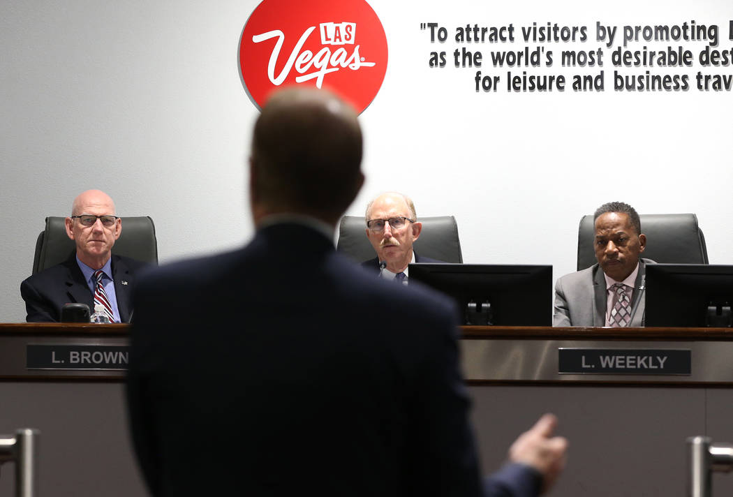 Las Vegas Convention and Visitors Authority board members from left, Larry Brown, Bill Noonan, and chairman Lawrence Weekly, listen to outside lawyer Todd Bice talk about an audit for the LVCVA re ...