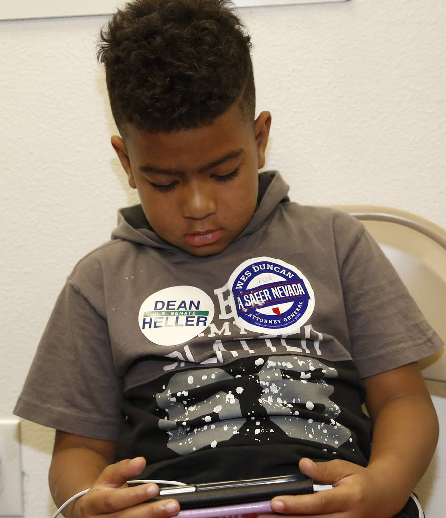 Jaylen Antonio Francis, 6, of Las Vegas plays games at a primary election night watch party, hosted by the Republican National Committee and Nevada Republican Party, on Tuesday, June 14, 2018, in ...