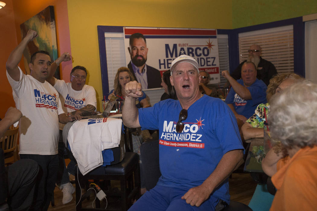 Les Boeman, center, cheers for Marco Hernandez, who is running for Clark County Commission District E, at his watch party at the La Cabana restaurant in Las Vegas, Tuesday, June 12, 2018. The pri ...