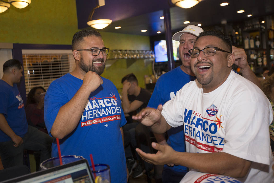 Marco Hernandez, who is running for Clark County Commission District E, from left, is cheered on by Les Boelman and Rogelio Gonzalez at his watch party at the Service Employee International Union' ...