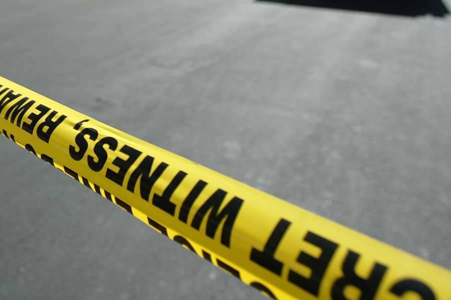 Police tape marks a crime scene.