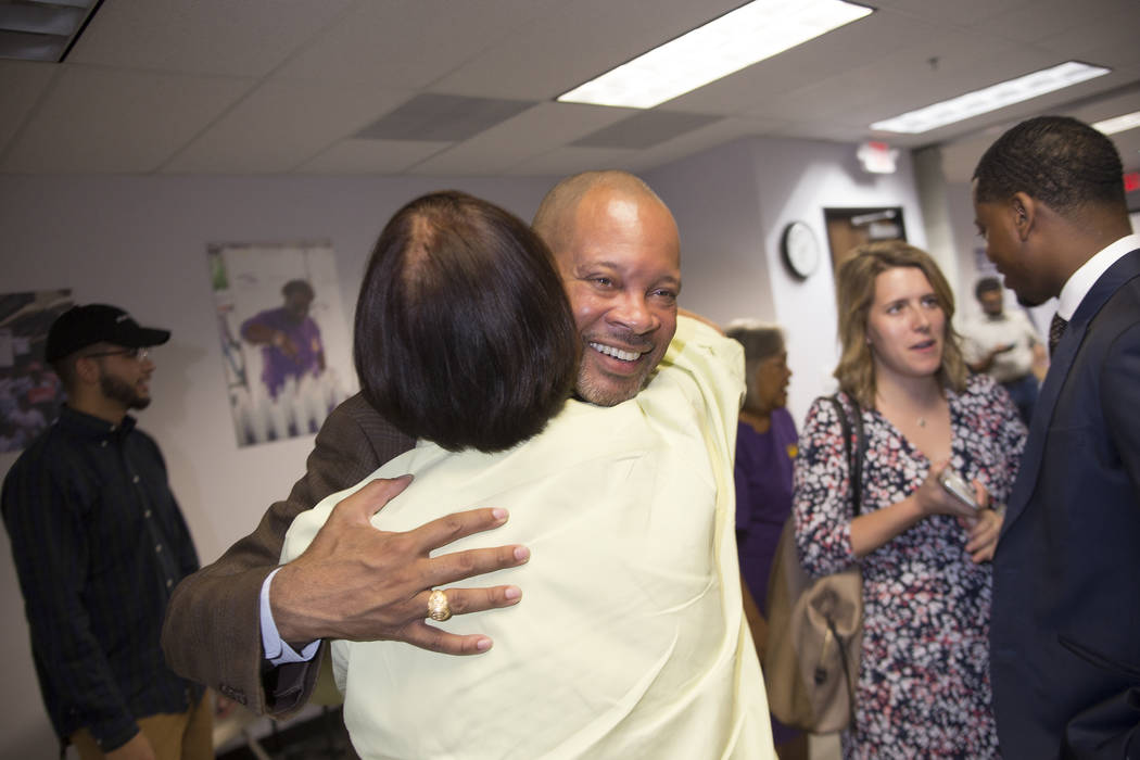 Senate Majority Leader Aaron Ford, D-Las Vegas, hugs Margie Gonzales, the former chair of the Asian American and Pacific Islander democratic caucus, at a Democrat primary election watch party at t ...