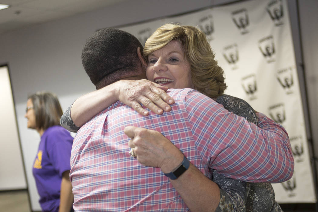 Connie Munk, a Democrat running for Nevada Assembly District 4, hugs Alex Goff at a Democrat primary election watch party at the Service Employee International Union's offices in Las Vegas, Tuesda ...