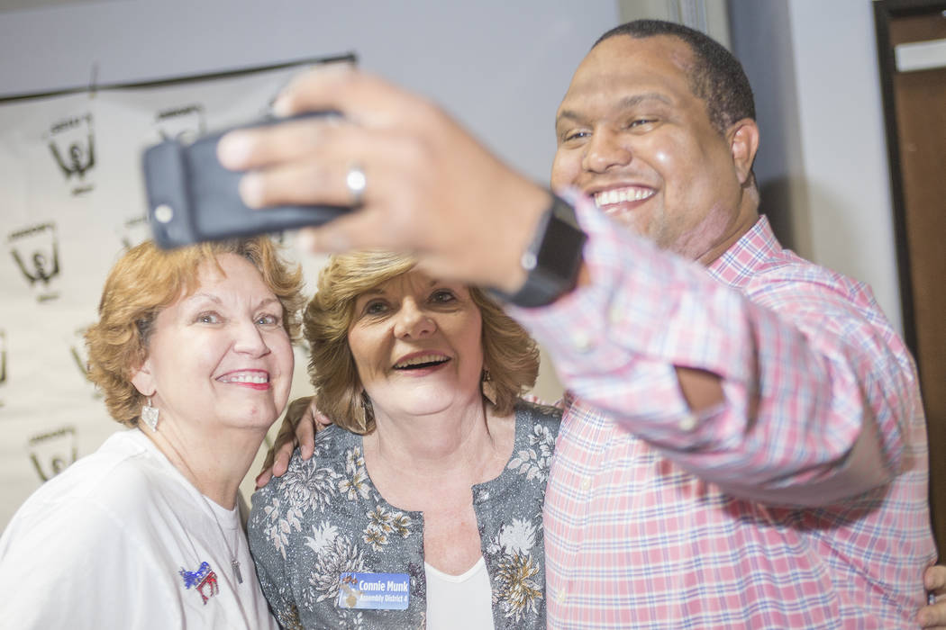 Donna West, the chair for the Clark Country Democratic party, from left, takes a selfie with Connie Munk, a Democrat running for Nevada Assembly District 4, and Alex Goff at a Democrat primary ele ...