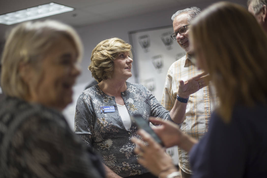 Connie Munk, who is running for Nevada Assembly District 4, talks to Ozzie Fumo at a Democrat primary election watch party at the Service Employee International Union's offices in Las Vegas, Tuesd ...