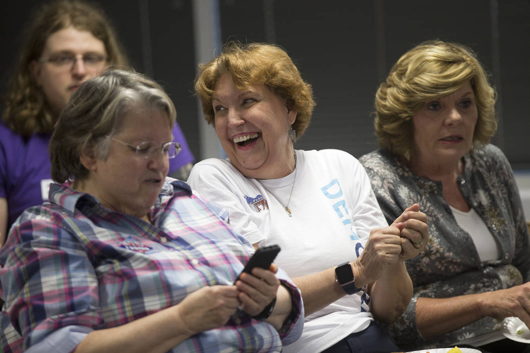 Donna West, the chair for the Clark Country Democratic party, center, laughs next to Connie Munk, right, a Democrat running for Nevada Assembly District 4, at a Democrat primary election watch par ...