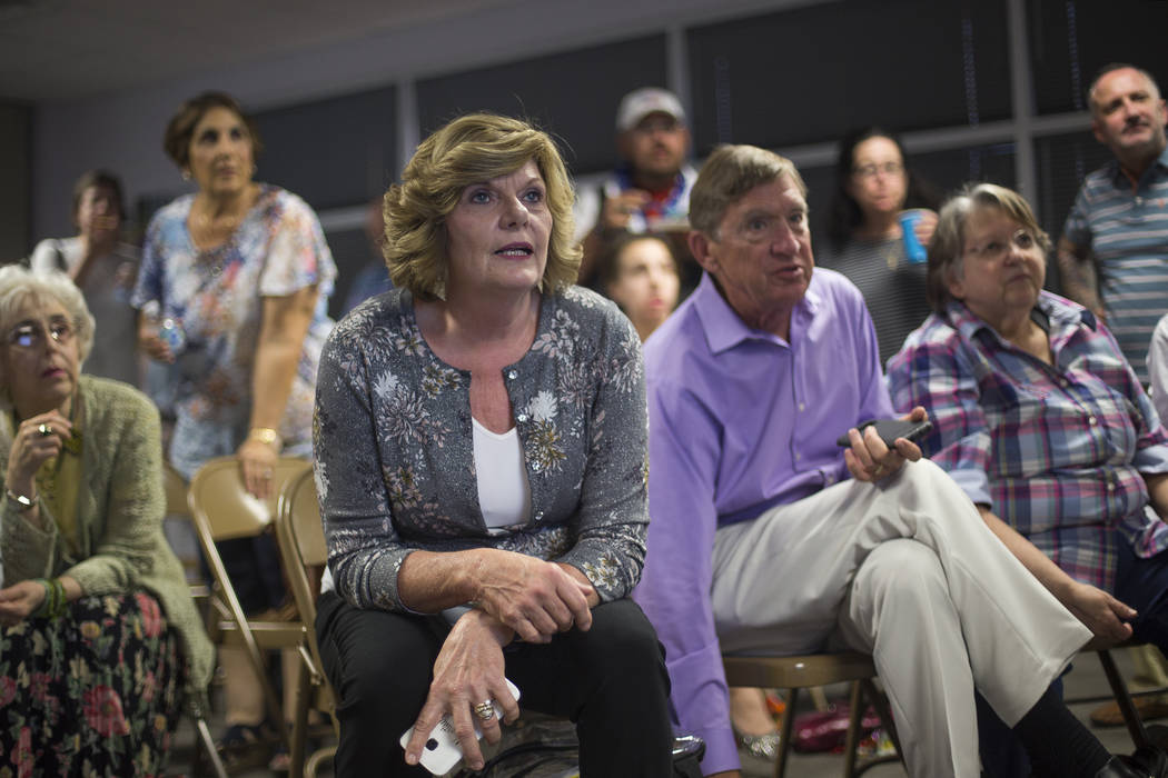 Connie Munk, a Democrat running for Nevada Assembly District 4, watches results next to her husband, Richard Munk at a Democrat primary election watch party at the Service Employee International U ...