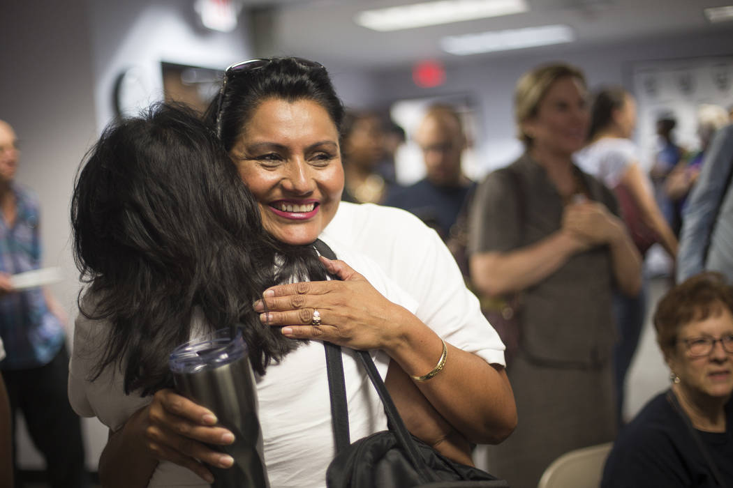 Susan Martinez, Democratic candidate for Assembly District 12, hugs her sister Adriana Martinez as results come in at a Democrat primary election watch party at the Service Employee International ...