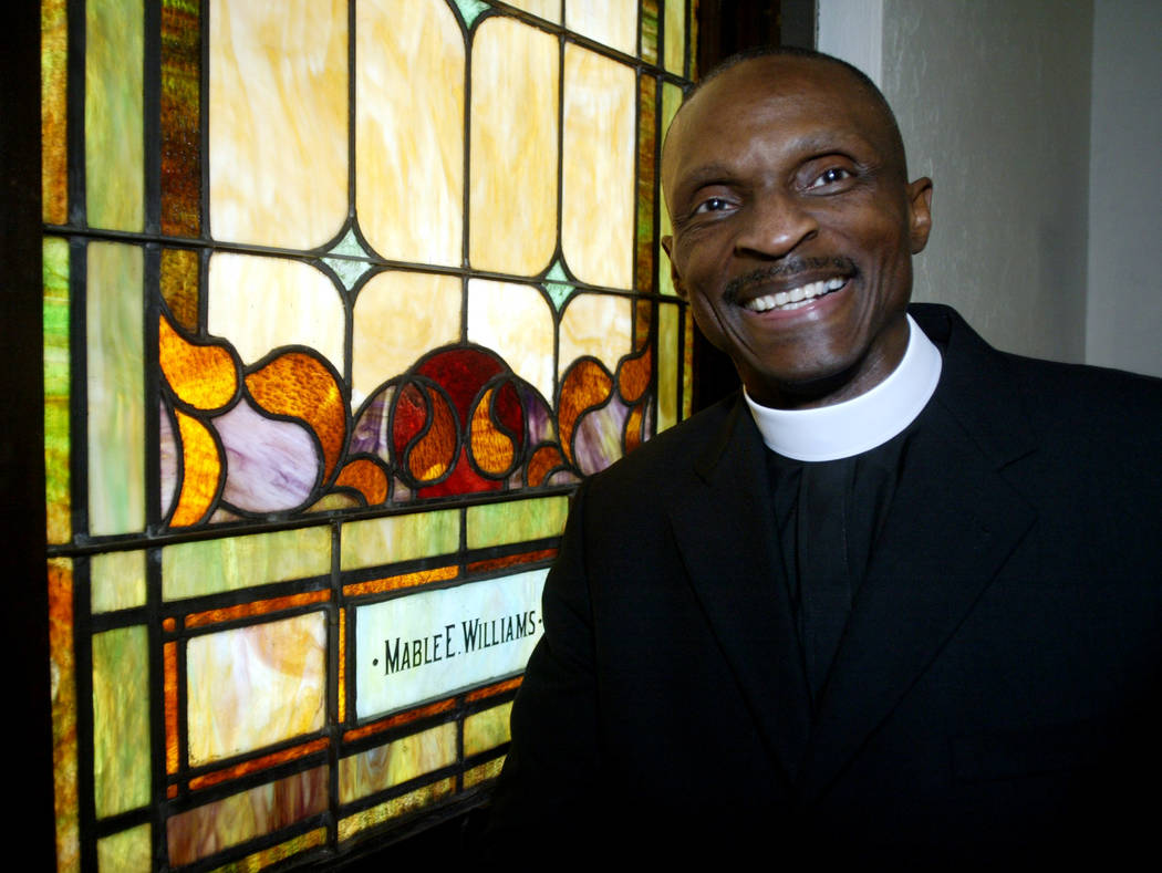 The Rev. Anthony Spearman, a pastor at Moore's Chapel AME Zion Church, in Salisbury, N.C., pauses before church services on Sunday, Jan. 25, 2004. (AP Photo/Nell Redmond)