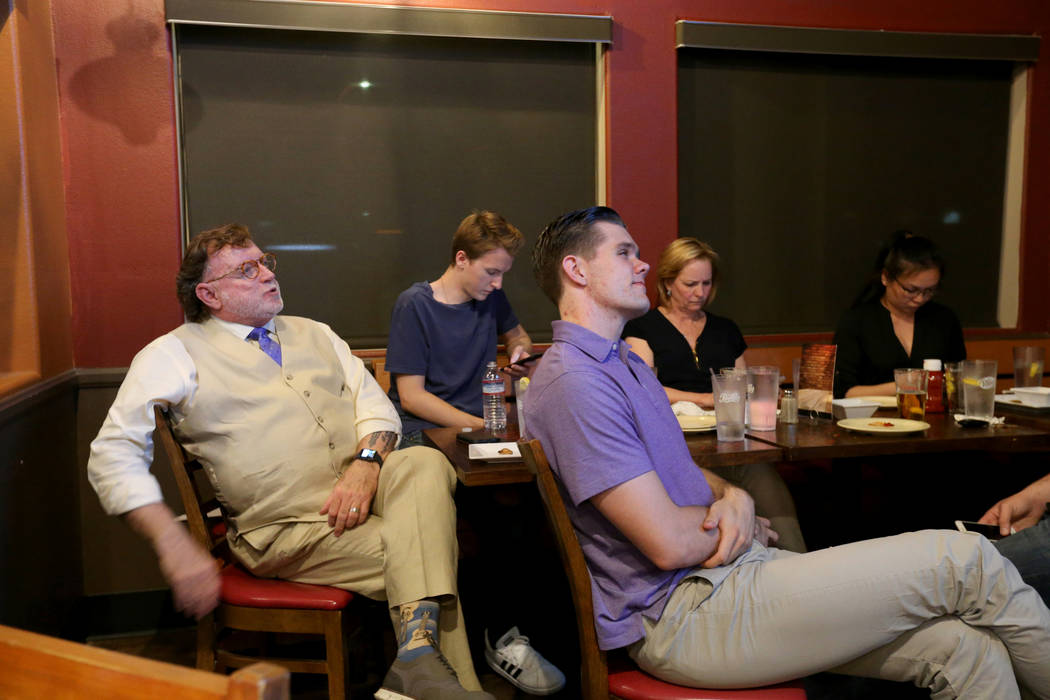 Clark County district attorney candidate, defense attorney Robert Langford, left, watches election results during a watch party at Bacon Bar on North Rancho Drive in Las Vegas Tuesday, June 12, 20 ...