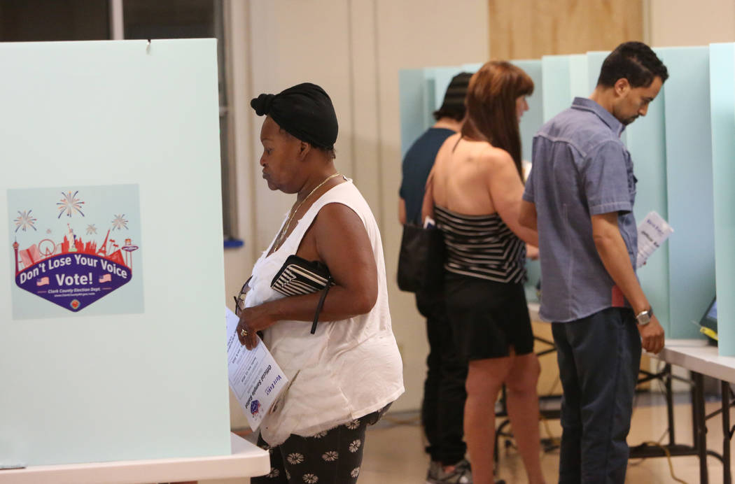 Voters cast their vote during Tuesday's primary election at a polling station at Kenny G. Guin Middle School on June 12, 2018, in Las Vegas Bizuayehu Tesfaye/Las Vegas Review-Journal @bizutesfaye