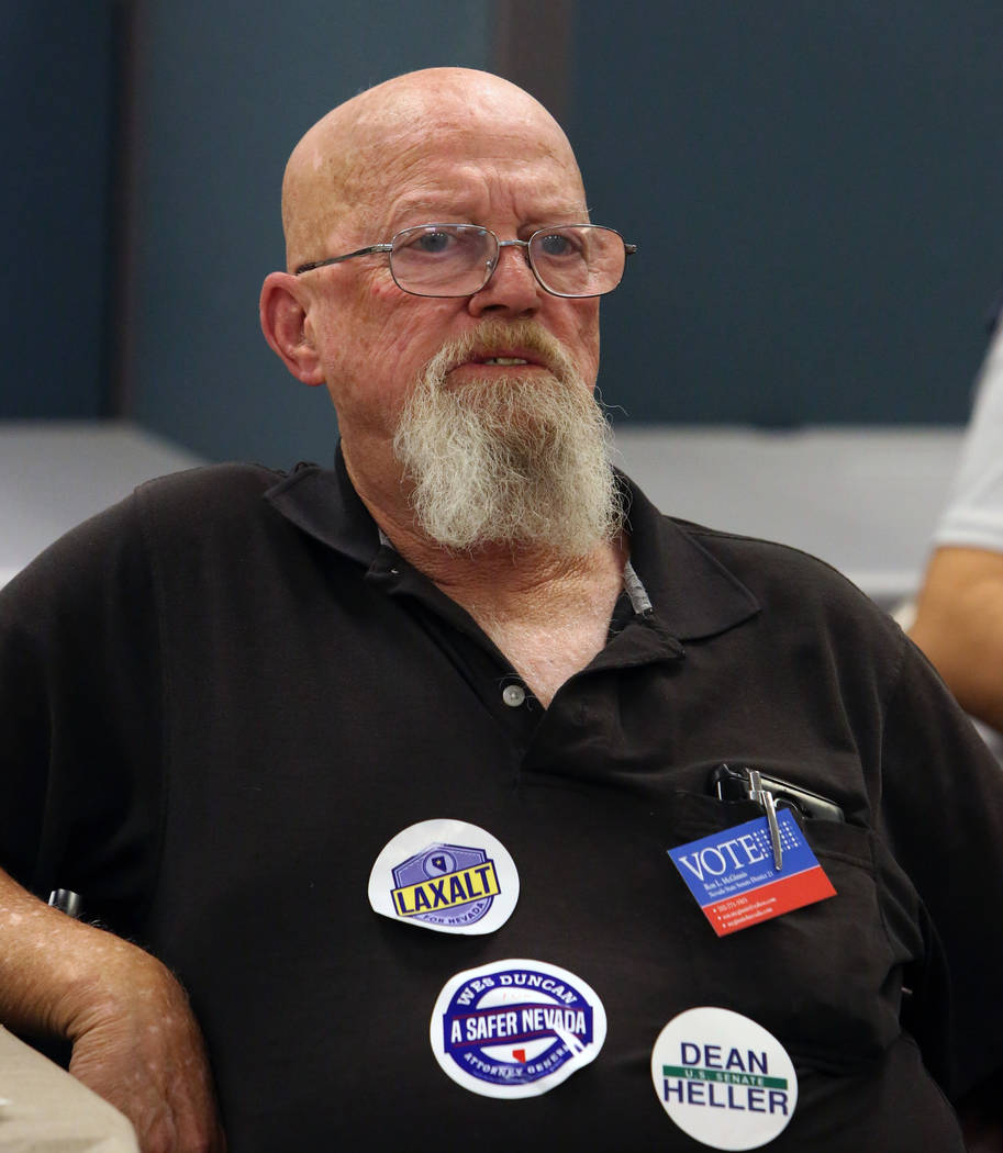 Ron McGinnis of Las Vegas watches update election results at a primary election night watch party, hosted by the Republican National Committee and Nevada Republican Party, on Tuesday, June 14, 201 ...
