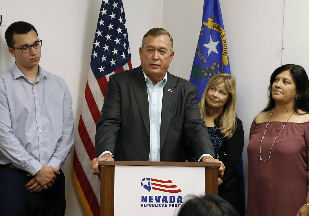 Cresent Hardy, Republican candidate for the 4th Congressional District, delivers his victory speech, as his wife Peri, second right, looks on at a primary election night watch party on Tuesday, Ju ...