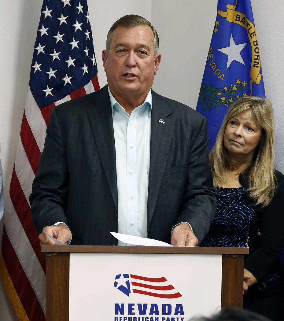 Cresent Hardy, Republican candidate for the 4th Congressional District, delivers his victory speech, as his wife Peri looks on at a primary election night watch party on Tuesday, June 14, 2018, in ...