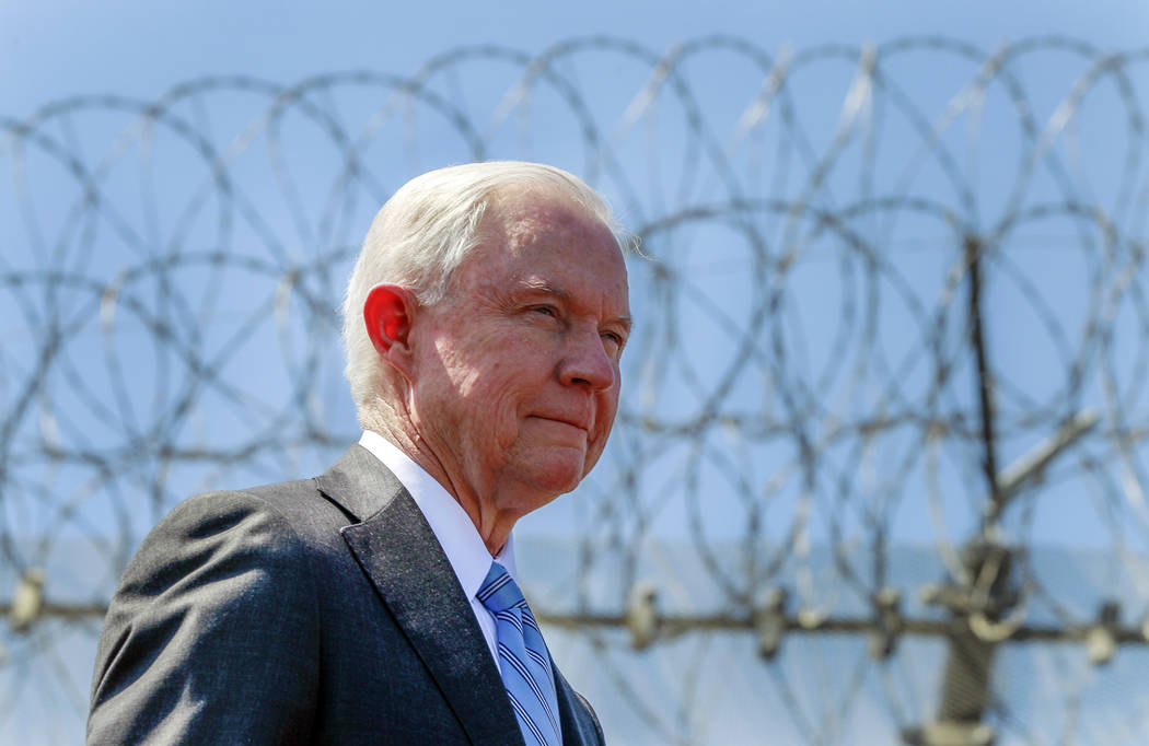 In this April 21, 2017 file photo, with razor wire across the top of the secondary border fence behind him, U.S. Attorney General Jeff Sessions attends a news conference at the U.S.-Mexico border ...