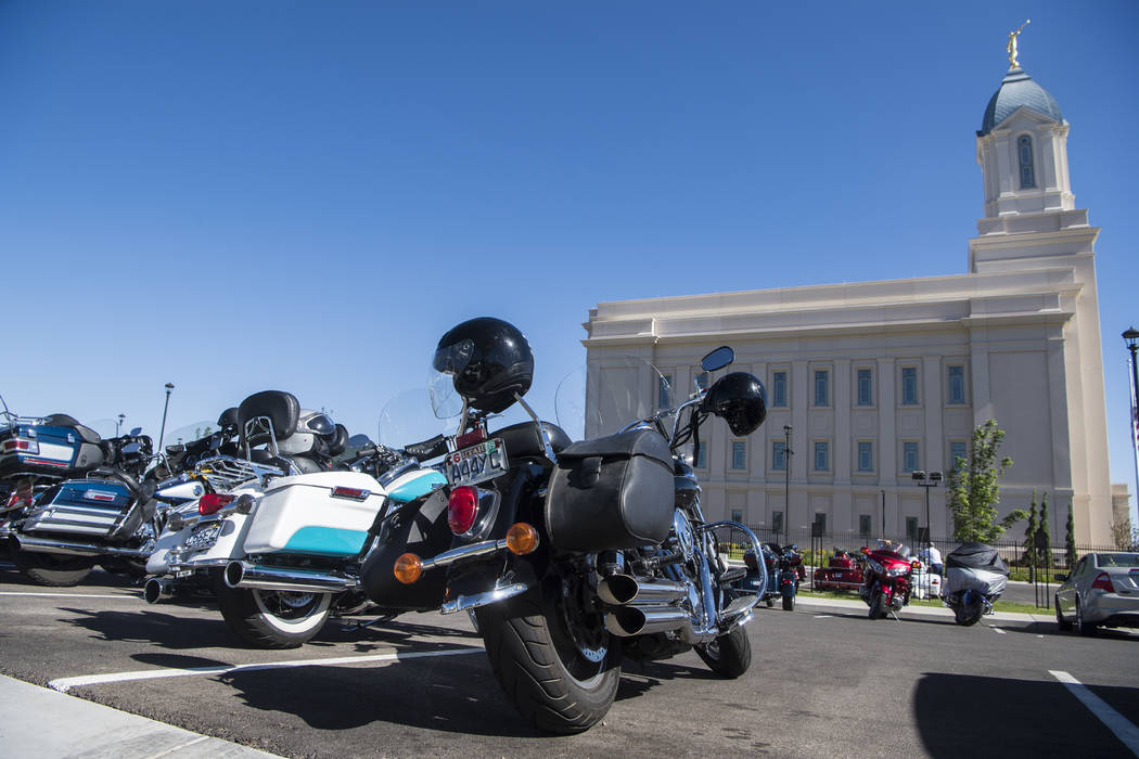 The Temple Riders, a faith-based motorcycle club visits the Cedar City Utah Temple as a stop on their biennial national rally Monday, June 11, 2018. The Temple Riders, a Mormon motorcycle club is ...