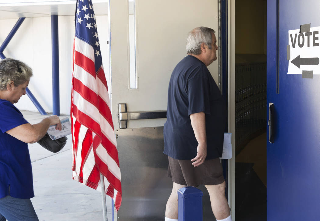 Voters arrive at a polling station to cast their vote during Tuesday's primary election at Kenny G. Guin Middle School on June 12, 2018, in Las Vegas. Bizuayehu Tesfaye/Las Vegas Review-Journal @b ...