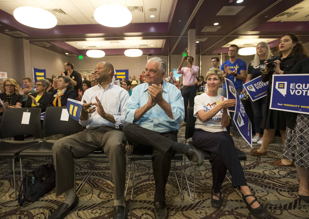 State Senator and Attorney General candidate Aaron Ford, from left, and Democratic gubernatorial candidates Steve Sisolak and Chris Giunchigliani applaud Congresswoman Dina Titus (not shown) durin ...