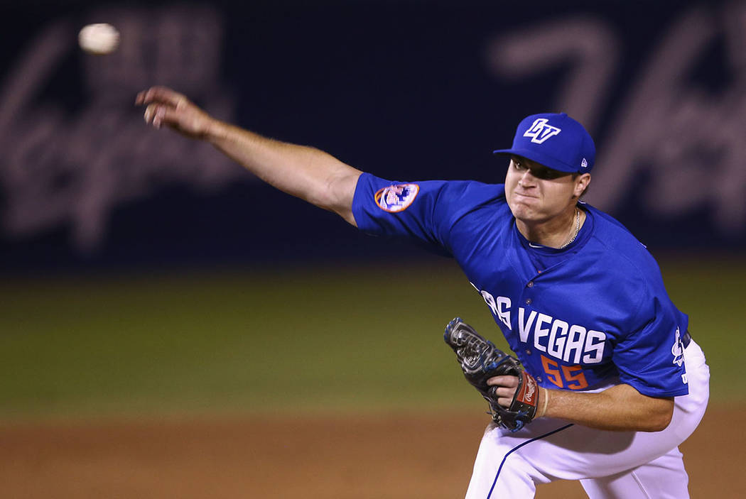 Las Vegas 51s pitcher Corey Oswalt (55) throws to the El Paso Chihuahuas during the opening day baseball game at Cashman Field in Las Vegas on Thursday, April 5, 2018. Chase Stevens Las Vegas Revi ...