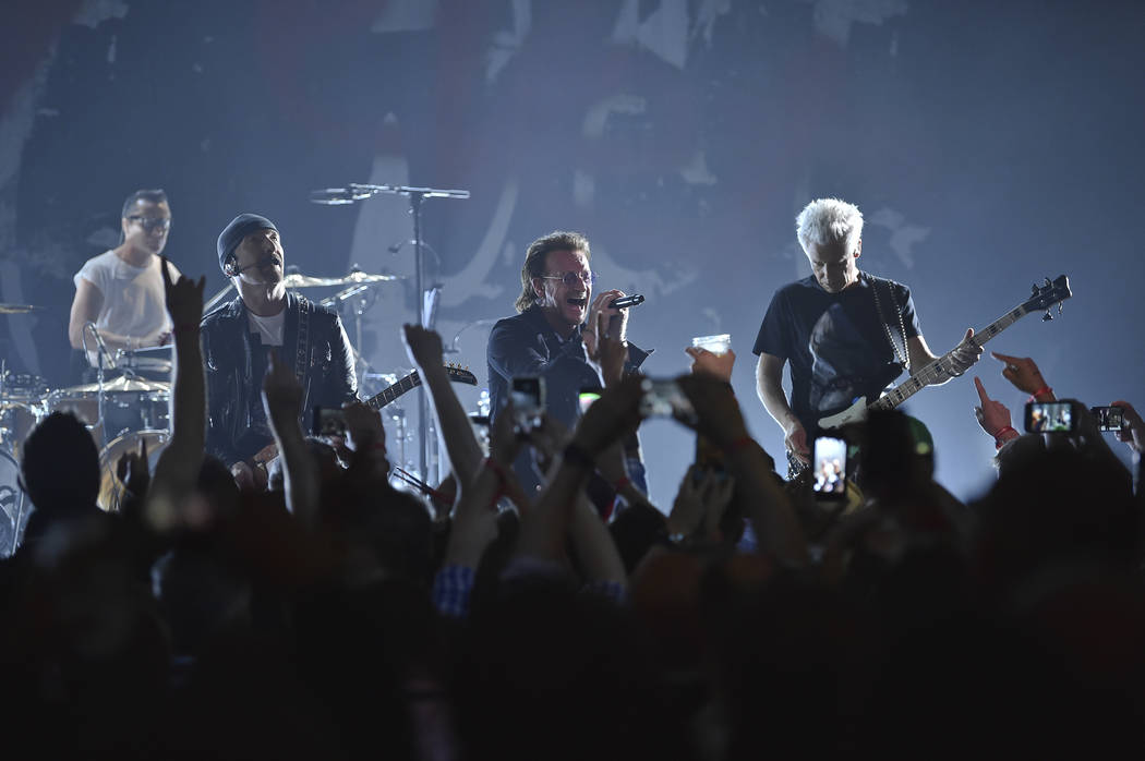Larry Mullen Jr, left, The Edge, Bono and Adam Clayton of U2 perform during a concert at the Apollo Theater hosted by SiriusXM on Monday, June 11, 2018, in New York. (Photo by Evan Agostini/Invisi ...
