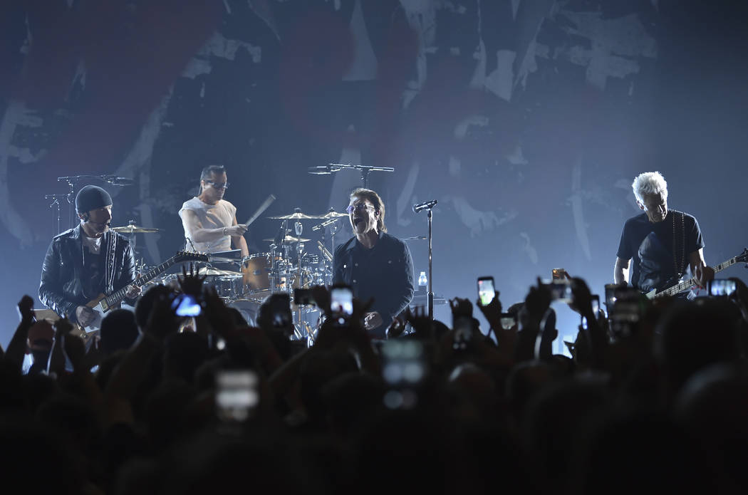 The Edge, left, Larry Mullen Jr., Bono and Adam Clayton of U2 perform during a concert at the Apollo Theater hosted by SiriusXM on Monday, June 11, 2018, in New York. (Photo by Evan Agostini/Invis ...