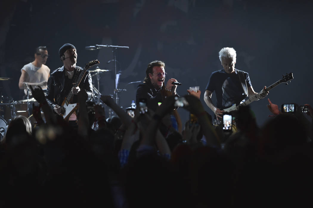 The Edge, left, Bono, Adam Clayton and drummer Larry Mullen Jr. of U2 perform during a concert at the Apollo Theater hosted by SiriusXM on Monday, June 11, 2018, in New York. (Photo by Evan Agosti ...