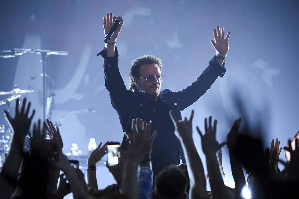 Singer Bono of U2 performs during a concert at the Apollo Theater hosted by SiriusXM on Monday, June 11, 2018, in New York. (Evan Agostini/Invision/AP)