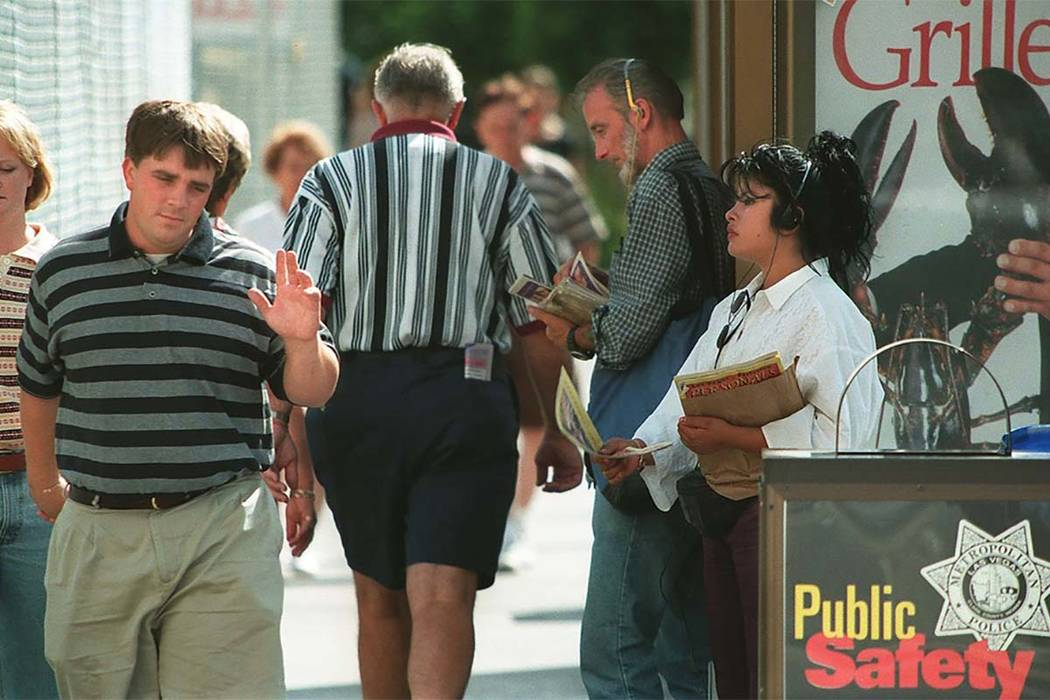 A tourist walking on the Las Vegas Strip waves off a handbill solicitor. (Las Vegas Review-Journal file photo)