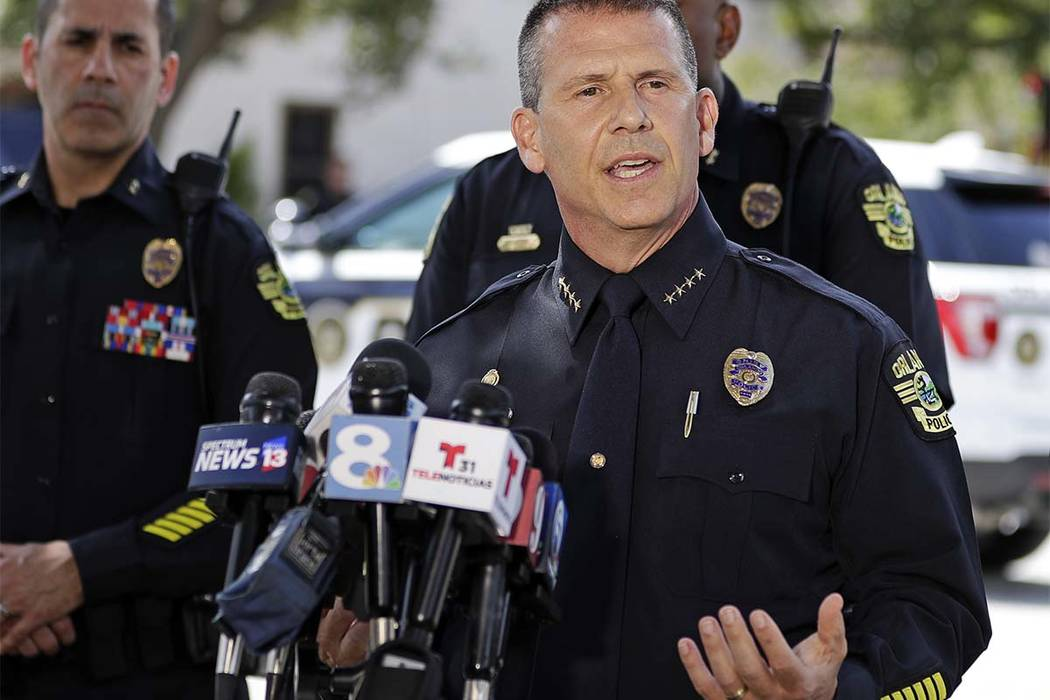 Orlando Police Chief John Mina answers questions at an afternoon news conference during a hostage standoff Monday, June 11, 2018, in Orlando, Fla. Police said a man suspected of battering his girl ...