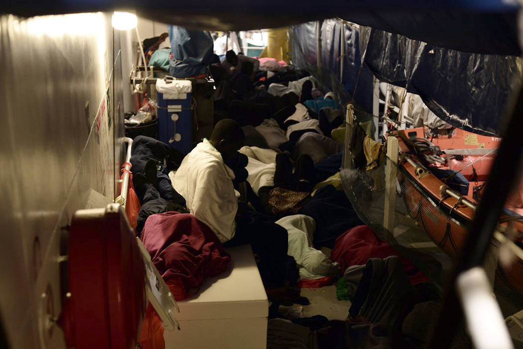 "This undated photo released by by French NGO ""SOS Mediterranee"" on Monday June 11, 2018 and posted on it's Twitter account, shows migrants aboard SOS Mediterranee's Aquarius ship and MSF (Doctors ..."