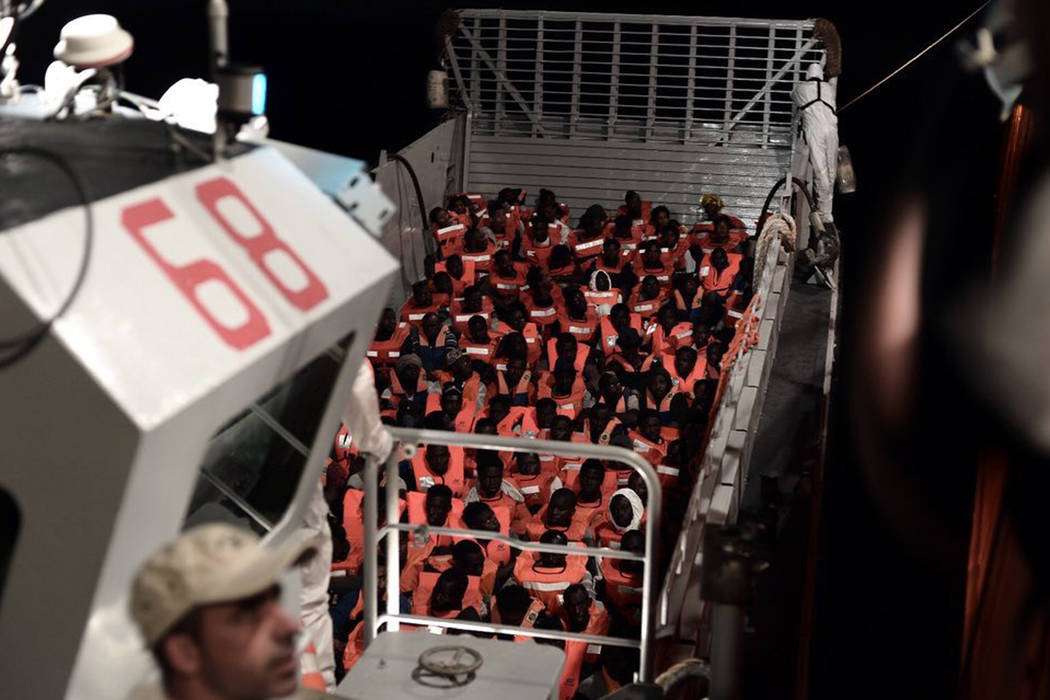 Aid group SOS Mediterranee Sea says it is transferring some of the 629 migrants rescued at sea to Italian ships to continue to the journey to Spain where the prime minister has offered safe harbor ...