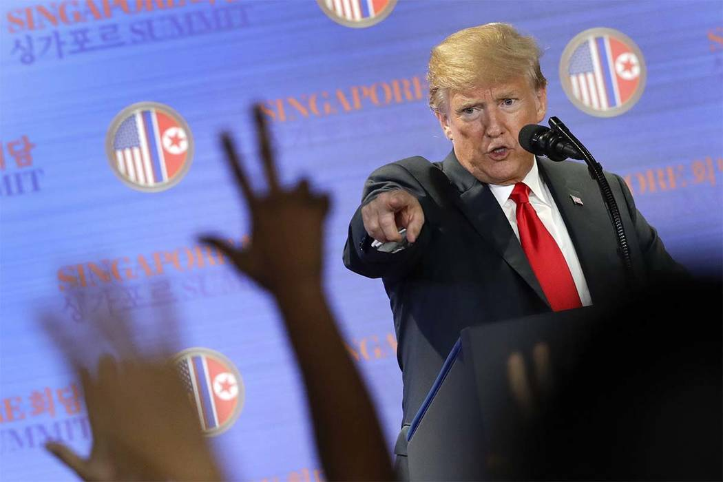 President Donald Trump answers questions about the summit with North Korea leader Kim Jong Un during a news conference at the Capella resort on Sentosa Island Tuesday, June 12, 2018 in Singapore. ...