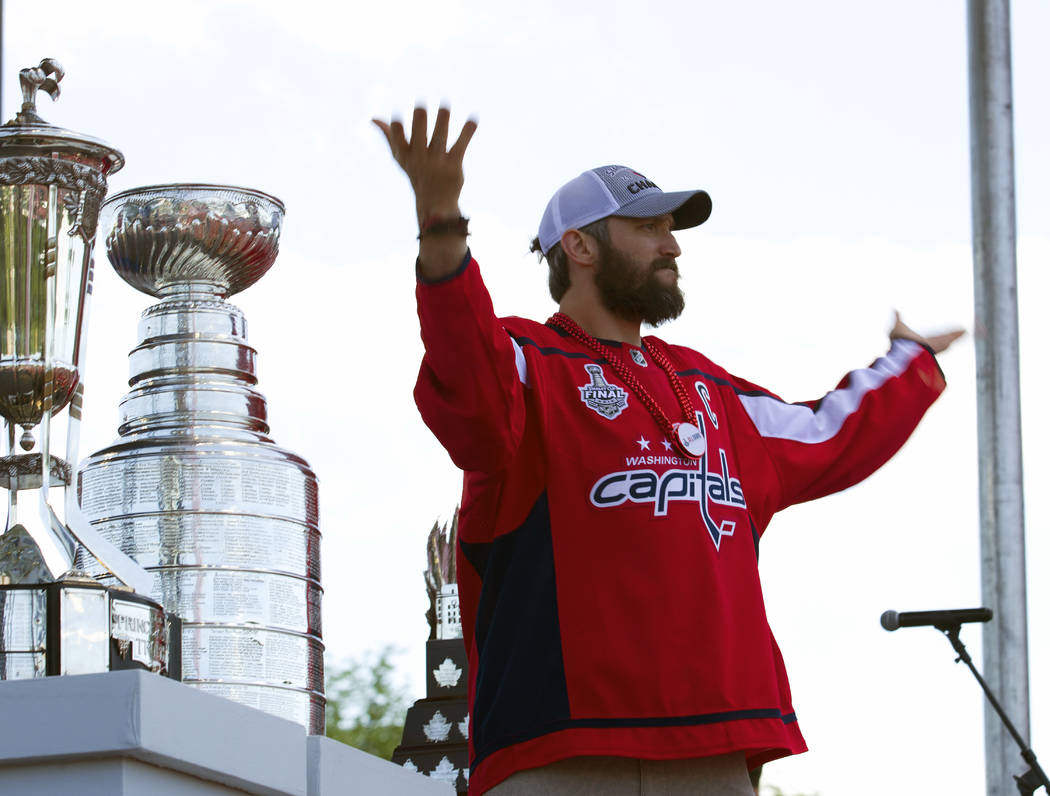 Washington Capitals NHL hockey team left wing Alex Ovechkin, from Russia, reacts to the crowd during a victory parade and rally at The National Mall, Tuesday, June 12, 2018, in Washington. (AP Pho ...