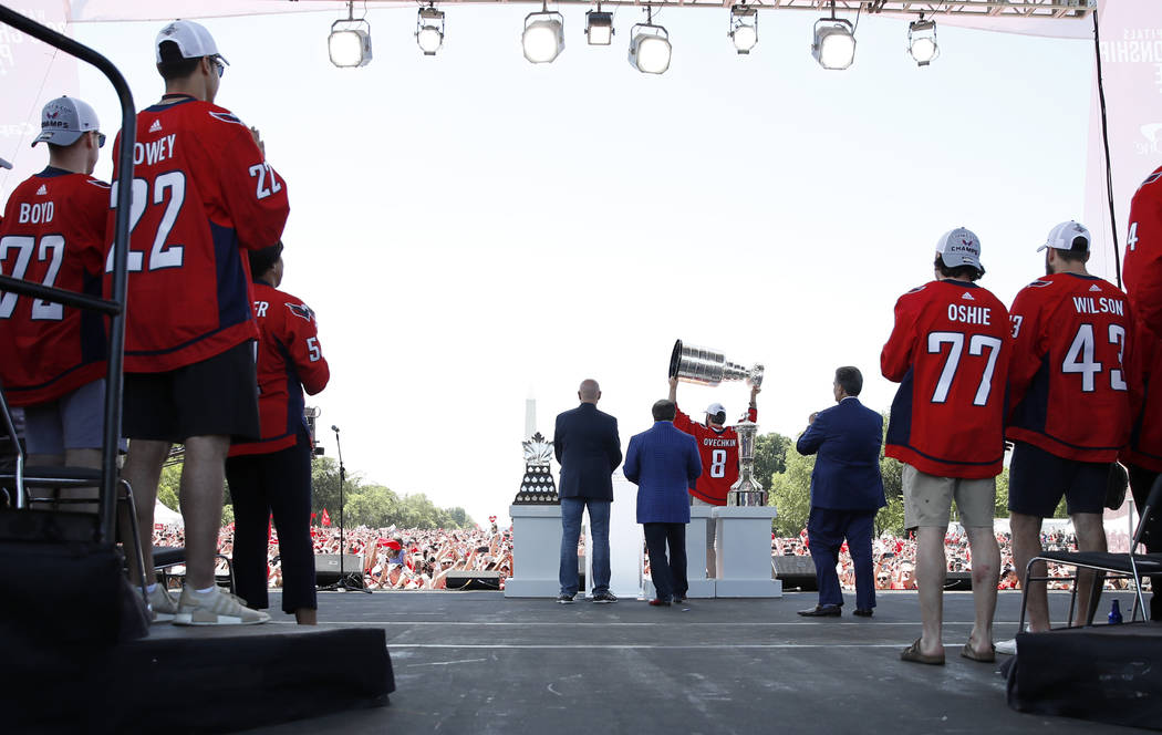 Washington Capitals left wing Alex Ovechkin (8), from Russia, holds up the Stanley Cup during a victory celebration, Tuesday, June 12, 2018, in Washington. (AP Photo/Alex Brandon, Pool)