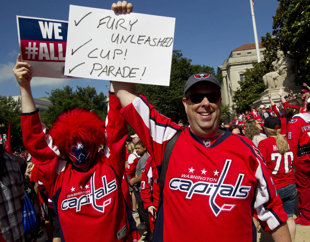 Fans cheers the Washington Capitals NHL Stanley Cup Championship hockey team during a victory parade and rally at The National Mall, Tuesday, June 12, 2018, in Washington. (AP Photo/Jose Luis Magana)