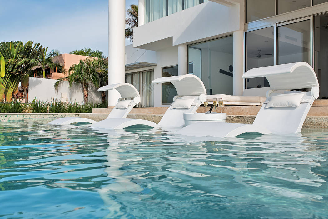 Ledge Lounger These homeowners selected Ledge Lounger in-pool furnishings for their tanning ledge. The items from the Signature series include three chaises with covered shades and pillows and a c ...