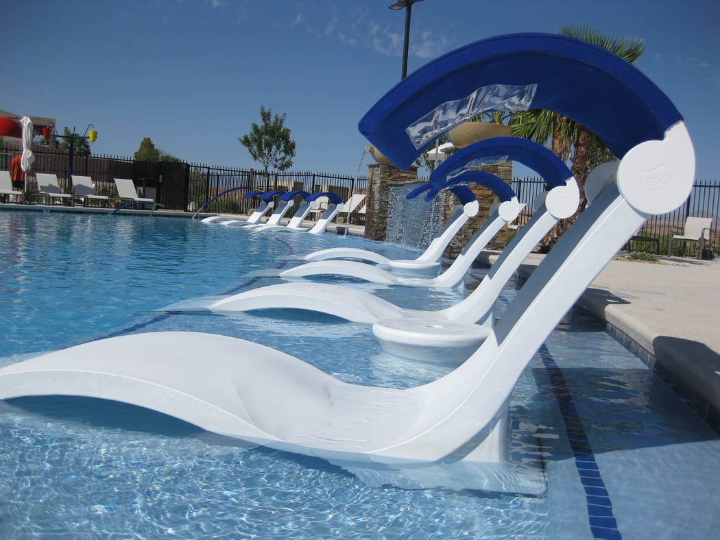 Paragon Pools Las Vegas Guests at this resort pool can enjoy a day of in-pool relaxation with the Signature Ledge Lounger chaise featuring the optional marine blue covered shade with a clear pouch ...