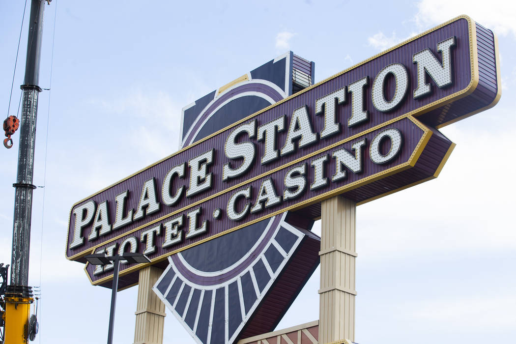The top piece of Palace Station's train sign is dismantled in Las Vegas, Monday, April 30, 2018. The marquee is the final train-themed remnant of the Station Casinos' first property. The hotel-cas ...