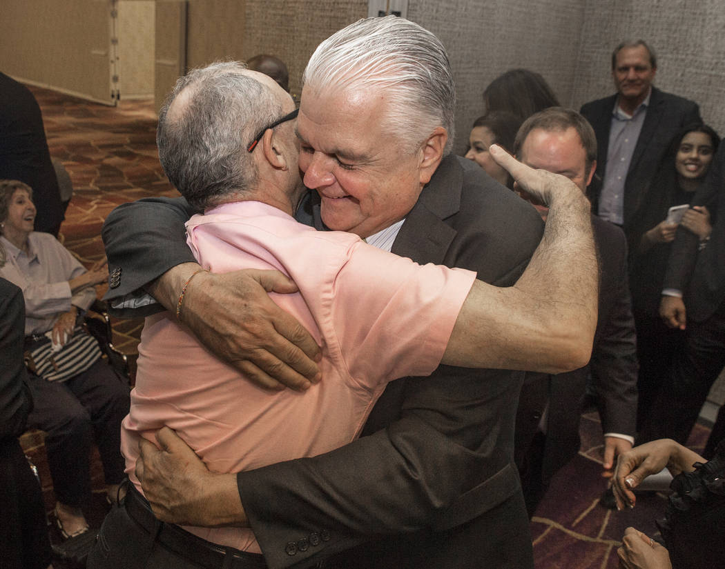 Steve Sisolak, right, hugs a supporter at a watch party after winning the gubernatorial democratic primary at the Aria hotel-casino on Tuesday, June 12, 2018, in Las Vegas. Benjamin Hager Las Vega ...