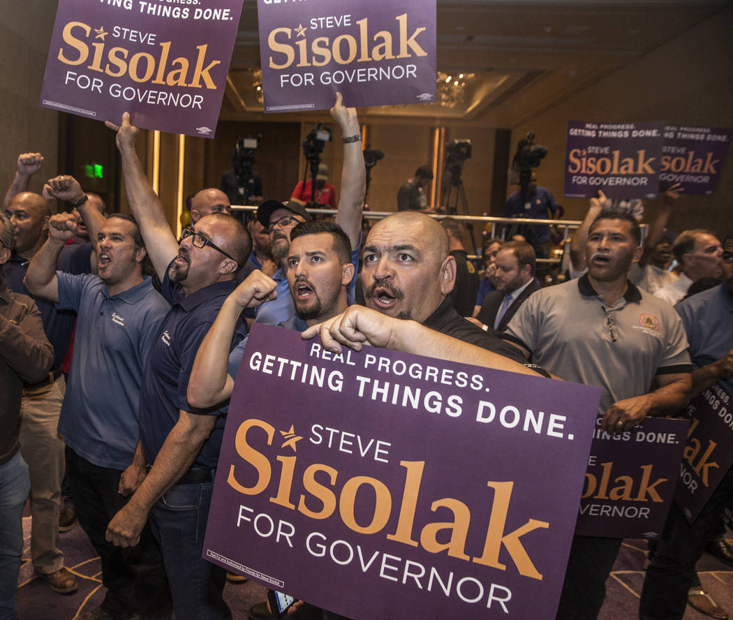 Supporters of Steve Sisolak cheer at a watch party after Sisolak won the gubernatorial democratic primary at the Aria hotel-casino on Tuesday, June 12, 2018, in Las Vegas. Benjamin Hager Las Vegas ...