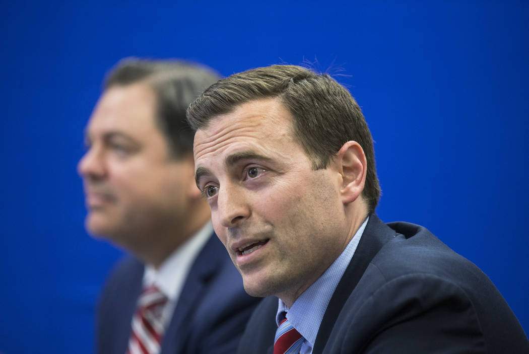 Adam Laxalt, right, Nevada Attorney General and gubernatorial candidate, listens to input from the crowd during a round table discussion on education reform on Wednesday, April 4, 2018, at Laxalt ...