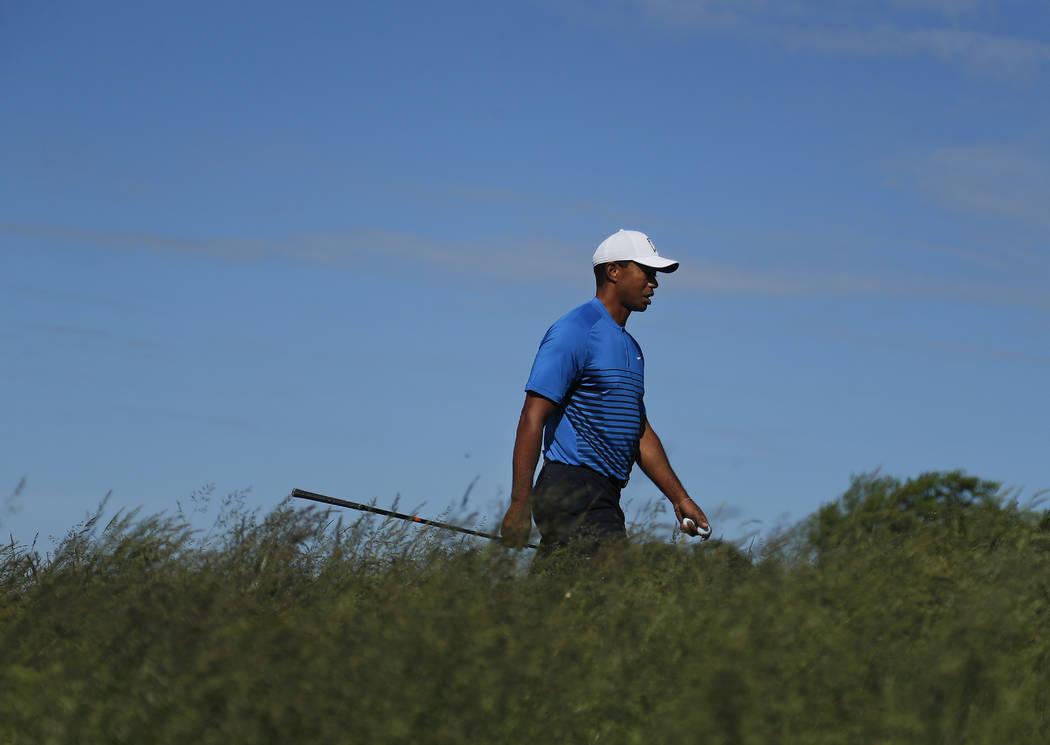 Tiger Woods walks up to the sixth tee during a practice round for the U.S. Open Golf Championship, Tuesday, June 12, 2018, in Southampton, N.Y. (AP Photo/Julie Jacobson)